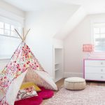 Pink Area Rug with Beach Style Kids and  White Table Lamp  Pink Area Rug  Built in Shelves  White Roller Shades  Yellow Throw Pillow
