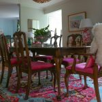 Pink Area Rug with Eclectic Dining Room and  Open Floor Plan  Pink Drapes  Bright Pink Seat Cushions  Bright Pink Area Rug  Pink Lamp