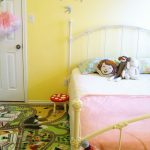 Pom Pom Rug with Eclectic Kids and  Bed Pillows  Wall Decor  Garland  Yellow Walls     Sock Monkey