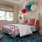 Pom Pom Rug with Eclectic Kids and  Girls Room  Mixed Pillows  Polka Dot Lampshade  Colorful Accents  Red Pillows