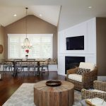 Pottery Barn Area Rugs with Contemporary Family Room and  White Trim  Tan Walls  Ceiling Lighting  Tv Above Fireplace  Mesh Doors