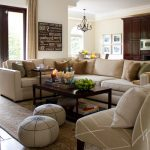 Pottery Barn Area Rugs with Traditional Family Room and  Rug  Neutral Colors  Window Treatment     Sectional Sofa  Tiled Floor