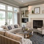 Pottery Barn Area Rugs with Traditional Living Room and  Beige Striped Sofa  Wall Sconce     Nailhead Trim  Blue Area Rug  Recessed Lighting