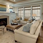 Pottery Barn Area Rugs with Traditional Living Room and  Ottoman  Grass Shades  Neutral Colors  Chair  White Wood Fireplace Mantle