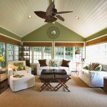 Pottery Barn Area Rugs with Traditional Sunroom and  Floral Pillows  Sloped Ceiling  Window Treatments  Throw Pillows  Area Rug