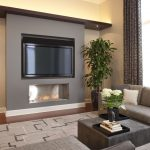 Ra Rugged Man with Contemporary Family Room and  Wall Mount Tv  Wood Flooring  Area Rug  Cove Lighting  Neutral Colors