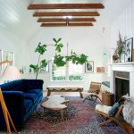 Ra Rugged Man with Farmhouse Living Room and  Wall Boarding     Fiddle Leaf Fig  Reclaimed Wood Floor  Chesterfield  Blue Tufted Sofa