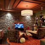 Ra Rugged Man with Transitional Home Theater and  Bookcase  Gallery Wall  Stacked Stone  Stone Wall  Baseboards