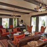 Ralph Lauren Rugs with Mediterranean Living Room and  Window Treatments  Deep Colors  Rug Layering  Chandelier  Drapes