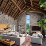 Red Area Rugs with Rustic Living Room and  Wood Ceiling  Stacked Stone Walls  Stone Siding  Cathedral Ceiling  Arched Doorways