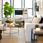 Rent Rug Doctor with Eclectic Living Room and  Fiddle Leaf Fig  Wood Floor     White Couch  Ottoman  Living Room