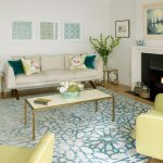 Rooms to Go Rugs with Contemporary Living Room and  Turquoise Throw Pillow  Wood Floor     Fireplace  Blue and Beige Rug  Beige Sofa
