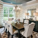 Rooms to Go Rugs with Transitional Dining Room and  Patterned Drapes  Beige Dining Chairs  White Lamps     Cove Ceiling  Drapery