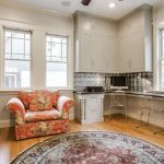 Round Braided Rugs with Transitional Home Office and  Glass Windows  Shaker Style  Acrylic Chairs  Hardwood Floors  White Molding