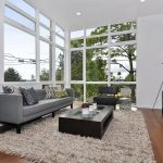 Rug Cleaning Nyc with Contemporary Living Room and  Recessed Lighting  Wood Flooring     Decorative Pillows  Gray Couch  Area Rug