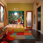 Rug Doctor Carpet Cleaner with Eclectic Kids and  Paintings  Accent Wall  Dark Stained Wood Floor  Red Molded Plastic Chairs. Kid's Clock  Pendant Light