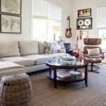 Rug on Carpet with Farmhouse Living Room and  Round Coffee Table  Artwork  Area Rug  Throw Pillows  Leather Lounge
