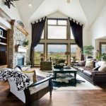 Rugged Maniac Denver with Contemporary Living Room and  Houseplants  Leather Sofa  Fireplace Mantel  Layered Rugs  Curtains
