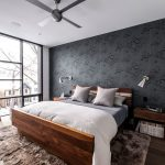 Sheep Skin Rug with Modern Bedroom and  Fan  Ceiling Fan  Master Bedroom  Bedside Tables  Accent Wall