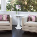 Sit Up Pillow with Arms with Contemporary Family Room and  Modern Side Chairs  Pink and Brown  White Side Table     Dark Wood Floors  Pattern
