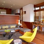Square Area Rugs with Midcentury Living Room and  Yellow Armchair  Built in Storage Provides an Open Feeling to the Living Room  Yellow Side Chair     Wood Counter  Bar Stool