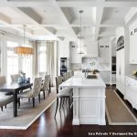 Square Area Rugs with Traditional Kitchen and  Dining Chairs  Bright  Kitchen Island  White Cabinets  Transom Windows