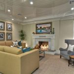 Square Area Rugs with Transitional Living Room and  Fireplace Hearth  Wingback Chair  Recessed Lighting  Ceiling Lighting  Glossy Ceiling