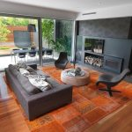 Standard Rug Sizes with Contemporary Family Room and  Fireplace  Round Ottoman  Gray Sofa  Glass Door  Patio