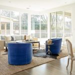 Standard Rug Sizes with Transitional Living Room and  Blue Club Chairs  Corner Windows  Great Room Living Room  Beige Wingback Chair  Round Glass Top Table