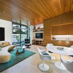 Teal Area Rug with Contemporary Family Room and  Sloped Ceiling  Teal Area Rug  Round Dining Table  Wood Ceiling     Curved Couch