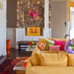The Dump Rugs with Eclectic Family Room and  Yellow Wall     Yellow Sofa  Pink Throw Pillow  Green Throw Pillow  Stone Wall