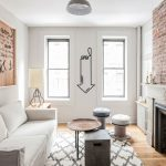 The Dump Rugs with Eclectic Living Room and  Exposed Bricks  Stencils  Repurposed Objects  White Couch  Tape Art