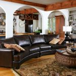 The Dump Rugs with Traditional Living Room and  Area Rug  Wicker Ottoman  Oriental Rug  Woven Coffee Table     Dark Brown Leather Sofa