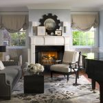 The Rug Company with Beach Style Living Room and  Wall Art  Fireplace Mantel  White Wood  Area Rug  Wood Trim
