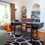 The Rug Market with Transitional Home Office and  Library  Tan Curtains  Den  Giraffe Rug  Wood Desk