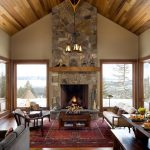 Traditional Area Rugs with Rustic Living Room and  Area Rug  Wood Fireplace Mantel  White Sofa  Table  Snow
