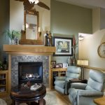 Tropical Area Rugs with Eclectic Family Room and  Recliner Chair  Ceiling Fan  Leather Chair  Table Lamp  Light Wood Mantle