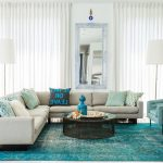 Turquoise Area Rug with Contemporary Family Room and  Floor Lamps  Turquoise Blue Area Rug  Symmetry  Aqua Blue Armchairs  Glass Top Round Coffee Table