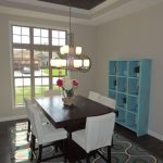 Turquoise Area Rug with Traditional Dining Room and  Turquoise Accents  White Leather Chair  Turquoise Shelf Display  Area Rugs Turquoise  Red Wood Dining Table