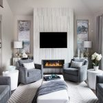 White Shag Area Rug with Contemporary Living Room and  White Round Side Table     Living Room Area Rug  Area Rugs in Living Room  Stylus Sofas  Grey Chairs