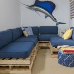 Yellow Chevron Rug with Beach Style Basement and  Pallet Sectional  Crate Sofa  Swordfish Artwork  Blue Ottoman  Blue Cushions