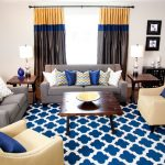 Yellow Chevron Rug with Contemporary Living Room and  Beige Walls  Nailhead Trim  Blue and Yellow  Dark Wood Flooring  Square Coffee Table