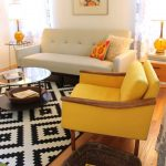 Yellow Chevron Rug with Midcentury Living Room and  Glass Side Table  		Amber Glass Lamp  Glass Coffee Table  Pixellated  Basket