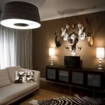 Zebra Skin Rug with Contemporary Family Room and  Brown Walls  Gallery Wall  Wall Mounts  Animal Bust  Neutral Colors