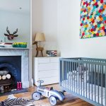 Zebra Skin Rug with Eclectic Nursery and  Style  Hanging Quilt  Racecar  Wooden Dog Lamp  Toy Moose Head