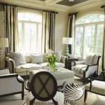 Zebra Skin Rug with Traditional Living Room and  White  Drapes  Painted Ceiling  X Back Chairs  Window Treatments