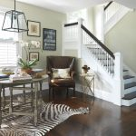 Zebra Skin Rug with Traditional Staircase and  Entry Table  Foyer  Stacked Books  Orchid  Wall Art